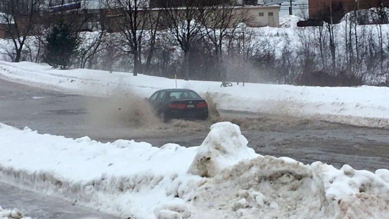 Storm floods homes, closes roads, knocks out power across