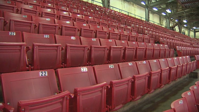 The Iconic Red Seating Of The Stampede Corral Justin