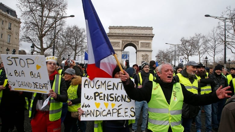 Day And Night Yellow Vest Protests Keep Pressure On Macron Cbc News