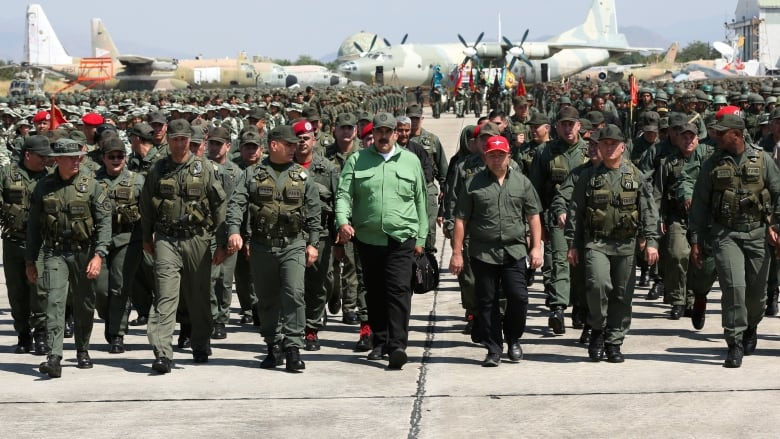 Venezuela air force general defects from regime and backs opposition leader