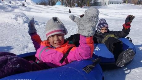 Kids enjoy the snow slides at Snowflake Kingdom