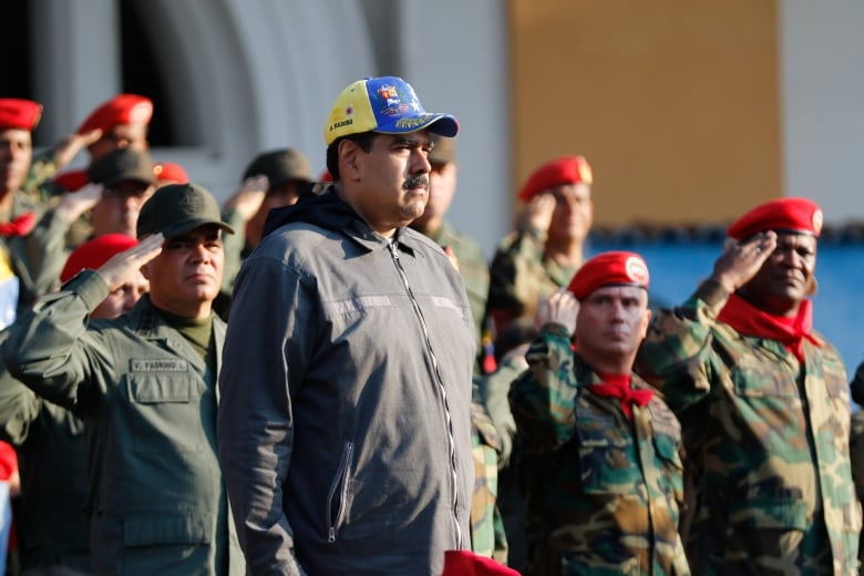 Maduro, at a ceremony with members of the country's security forces on Monday, blames U.S. sanctions and an 'economic war' waged by business elites for Venezuela's economic turmoil. (Miraflores Palace/Handout via Reuters)