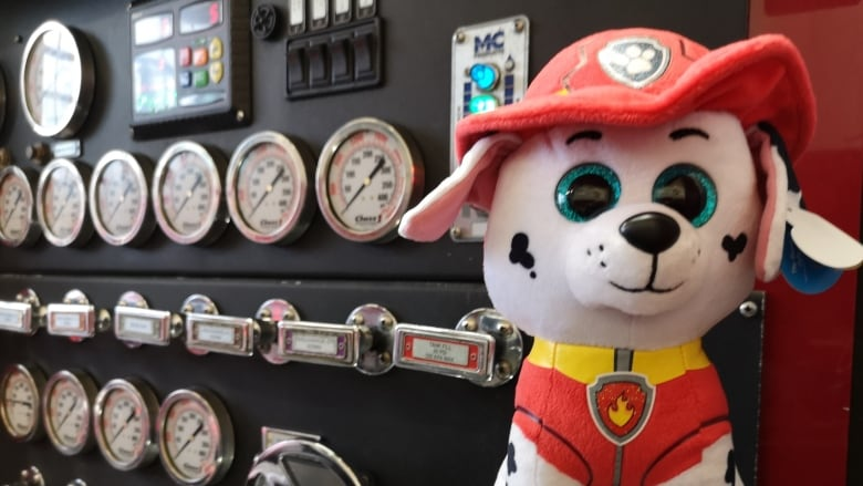 4db9426b79de Halifax Regional Fire and Emergency hands out plush fire dogs as part of  their Hug a Dog program. (Brian MacKay/CBC)