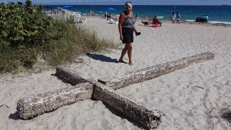 A divine intervention': 6-m cross covered in barnacles