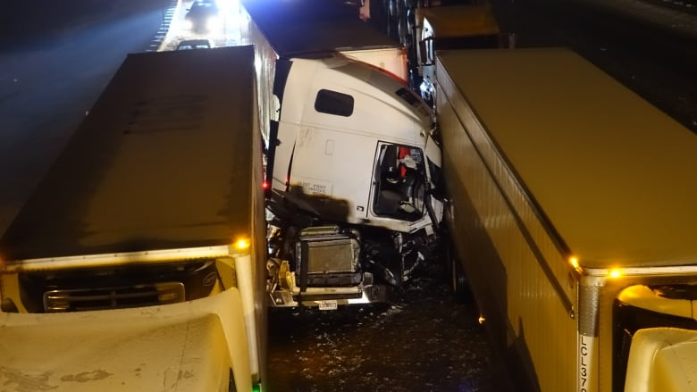 Heavy truck and car pileup on Highway 20 leaves 1 dead, 2