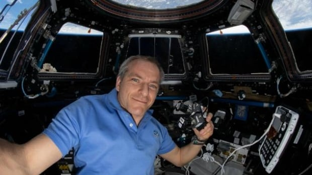 Canadian astronaut David Saint-Jacques helps repair leaky space toilet