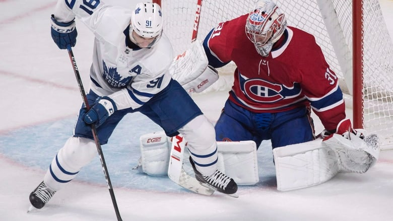 Toronto Maple Leafs  John Tavares moves in on Montreal Canadiens goaltender  Carey Price. A matchup between the two teams highlights Hockey Day in  Canada ... 6cc76536e348