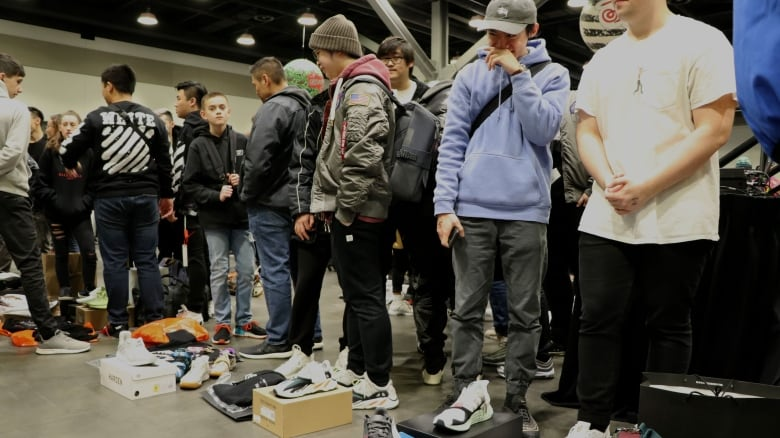 cedfc6a245619 A row of sellers in the trade pit at Vancouver Sneaker Con. Most of the  sellers were young men. (Maryse Zeidler CBC)