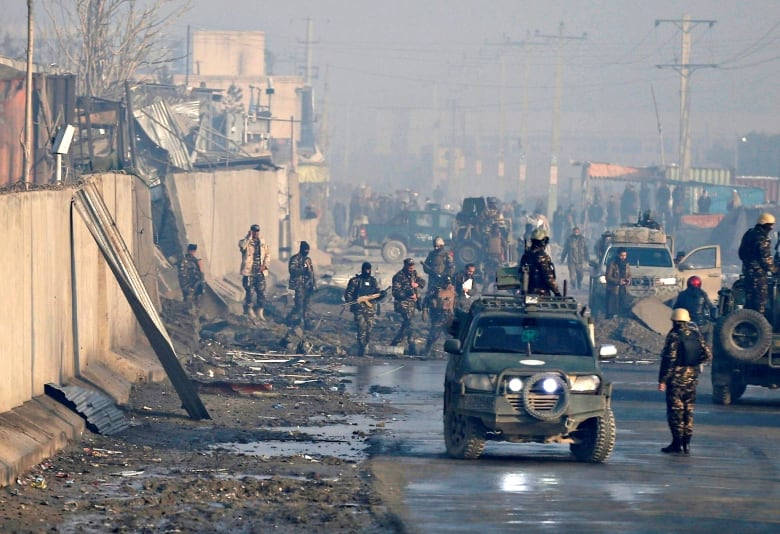In January Afghan security forces inspected the site of a car bomb blast in Kabul