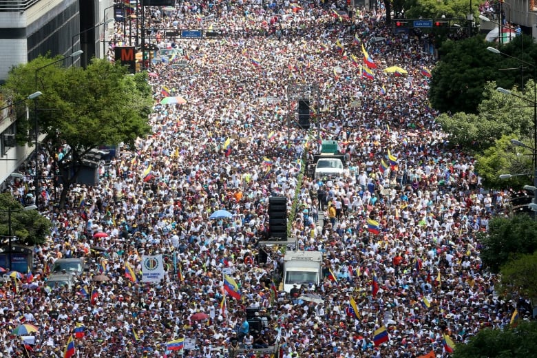 Thousands of protesters gather at Avenida Francisco de Miranda during a demonstration organized by Guaido in February 2019 in Caracas. Venezuelans demanded that the military let humanitarian aid into the country. (Edilzon Gamez/Getty Images)