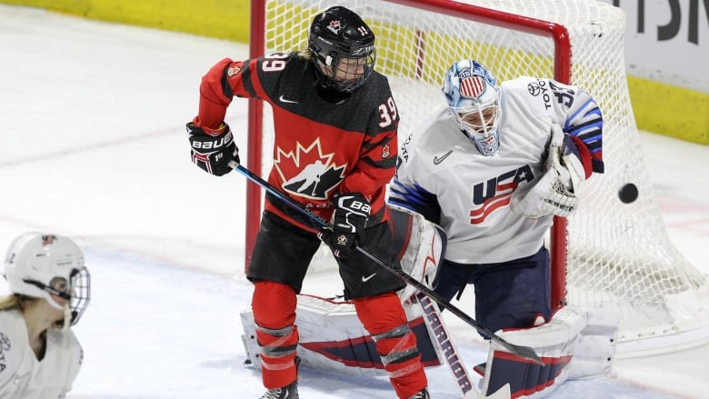 c0d624d8cc4 United States goaltender Alex Rigsby (33) makes a save in front of Canada  forward Ann-Sophie Bettez (39) during the second period.