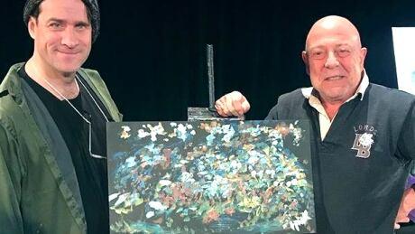 Bruce Horak, with portrait auction winner John Leansie