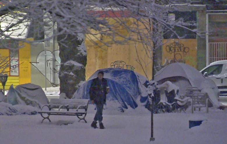 About 50 people are now spending the night in tents at Oppenheimer Park. (CBC) & Homeless in the snow: Tent community growing in Vancouver park amid ...
