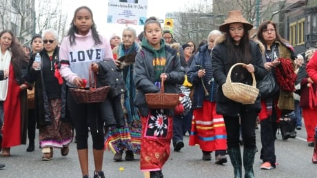 Young women lead the memorial march