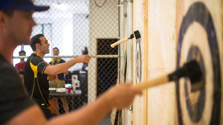 From pubs to pro leagues: Canada's axe throwing craze has spawned ...