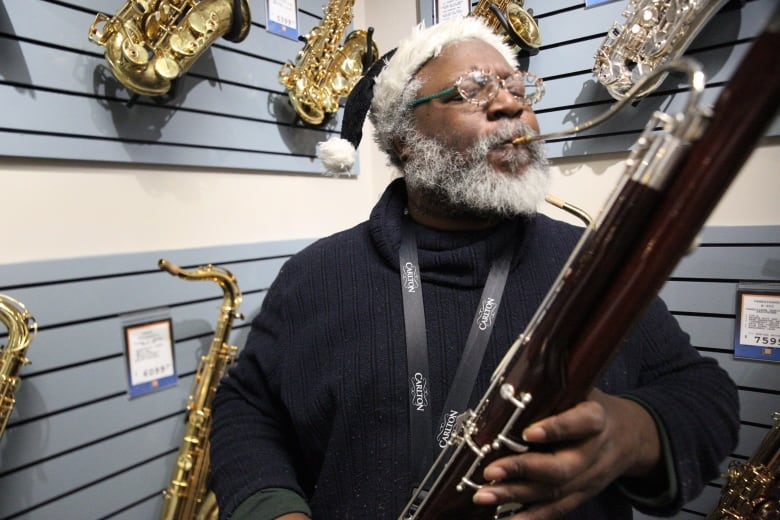 Friends come together to raise $10K to replace local busker's stolen bassoon