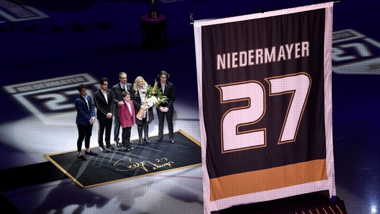 Former Ducks captain Scott Niedermayer watches along with his family as his  No. 27 is raised to the rafters in Anaheim. (Mark J. Terrill Associated  Press) 951e71e62