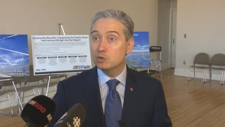 Infrastructure minister announces no tolls for cyclists on Gordie Howe Bridge