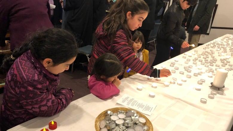 Community where Barho family first settled holds vigil in memory of children