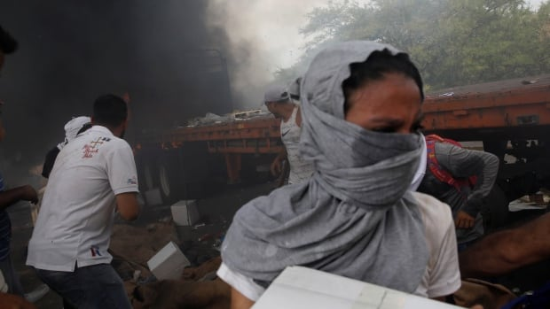 Venezuelans scramble for aid amid deadly clashes with military at border
