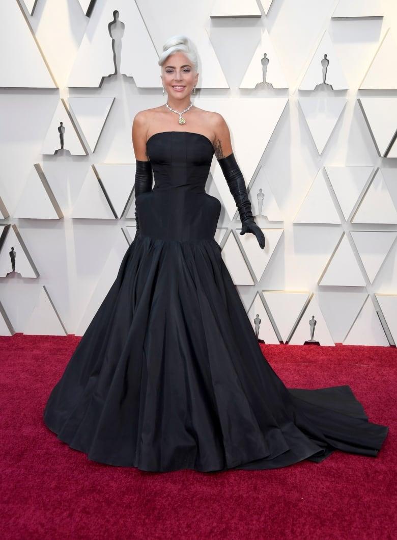 Constance Wu, Billy Porter shine on Oscars red carpet ...