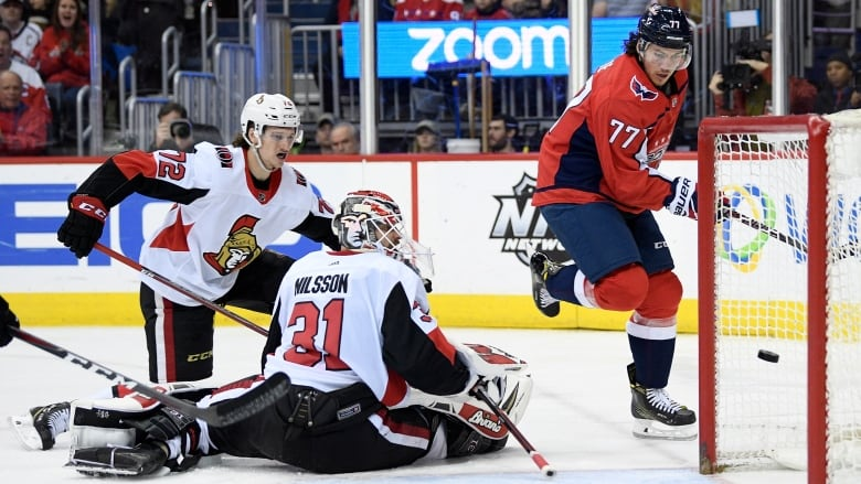 26f0f25a77f Washington s T.J. Oshie puts the puck past Ottawa goaltender Anders NIlsson  in the Capitals  win on Tuesday. (Nick Wass Associated Press)