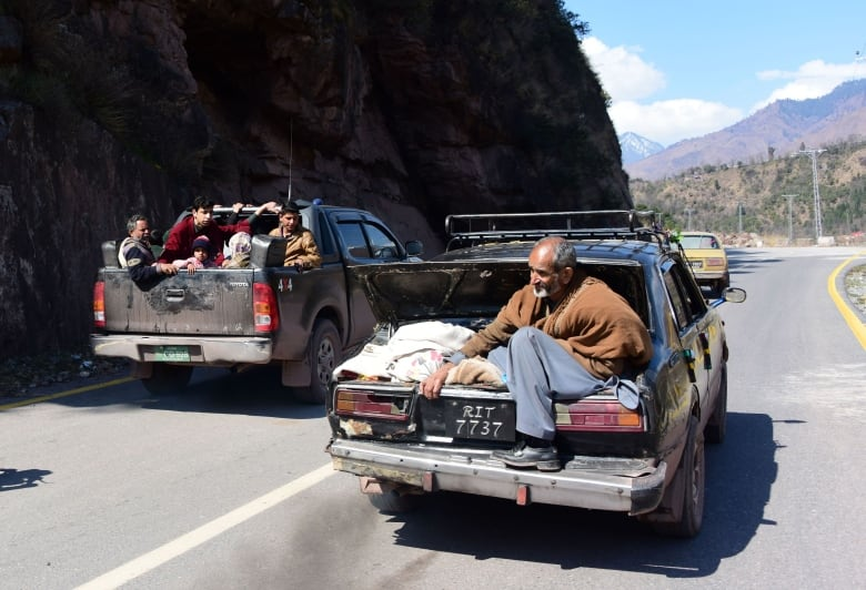Pakistani Kashmiri residents evacuate from the border town of Chakothi in Pakistan administered Kashmir
