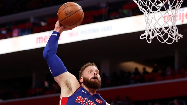 fe0da7f9c210 Detroit Pistons forward Blake Griffin (23) goes for a dunk over Toronto  Raptors centre Serge Ibaka (9) during the first half of their game on  Sunday in ...