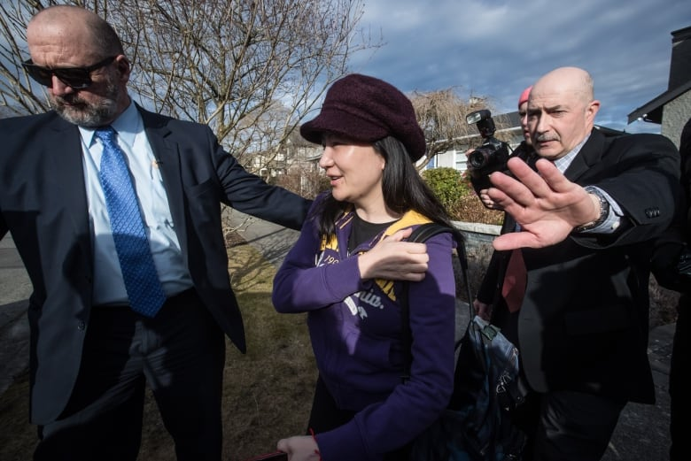 Huawei's chief financial officer, Meng Wanzhou, centre, was detained Dec. 1 in Vancouver at the behest of U.S. authorities. (Darryl Dyck/Canadian Press)