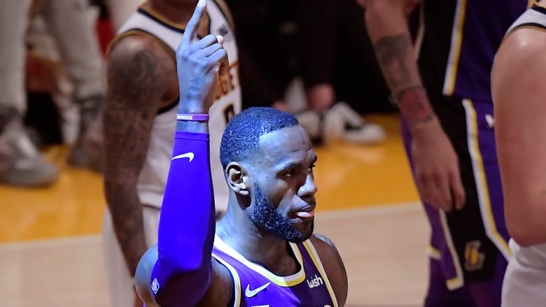 b470bbc35a0 Los Angeles Lakers forward LeBron James gestures after scoring during the  first half on Wednesday night. (Mark J. Terrill The Associated Press)