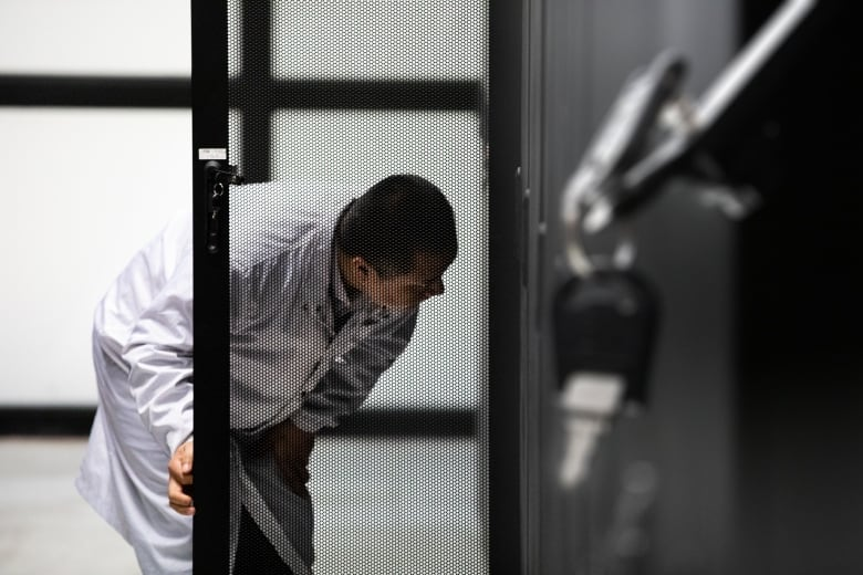 A Huawei technician inspects servers at the company's cyber security lab in Dongguan. (Saša Petricic/CBC)