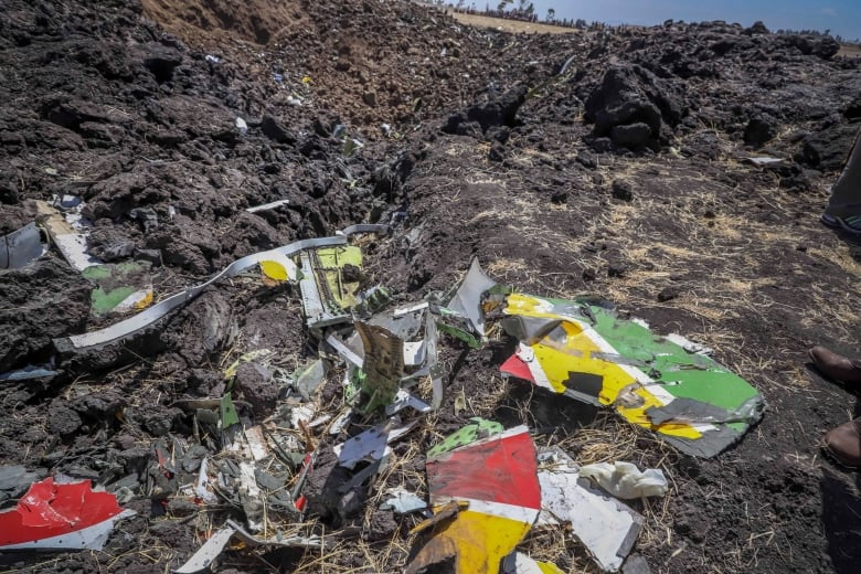 Wreckage lies at the scene of an Ethiopian Airlines flight that crashed shortly after takeoff. (Associated Press)