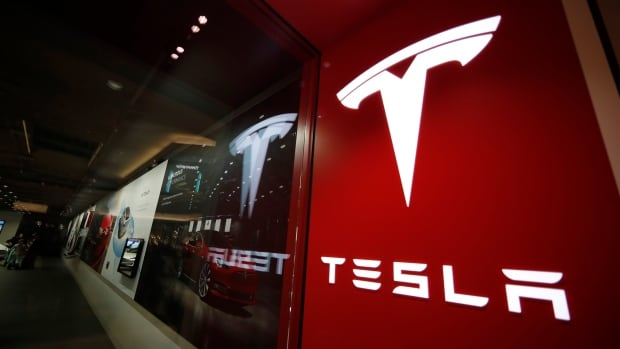 Tesla, now strongly linked to Bitcoin, drops in value as cryptocurrency plummets | CBC News