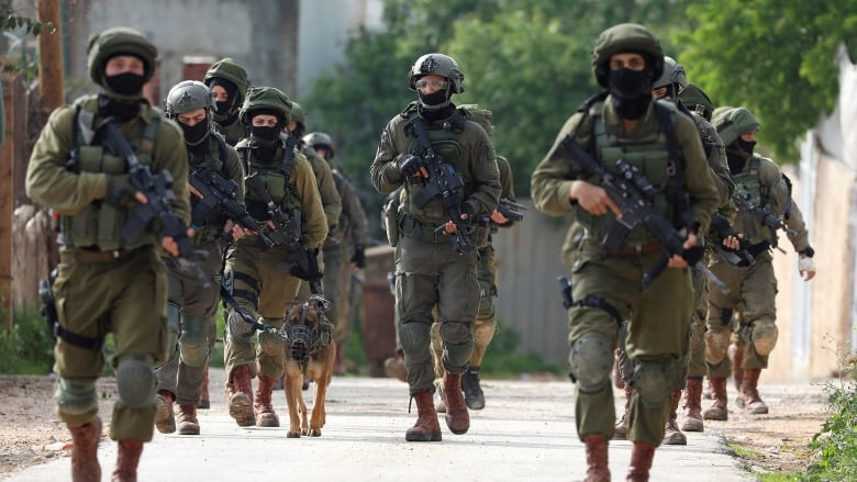 West Bank manhunt underway after fatal attack