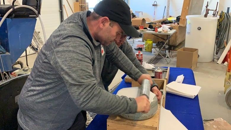 ebe50867a6007 Ice technician Greg Ewasko goes through the task of