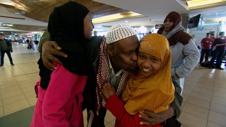 Edmonton man reunites with daughters who fled conflict in