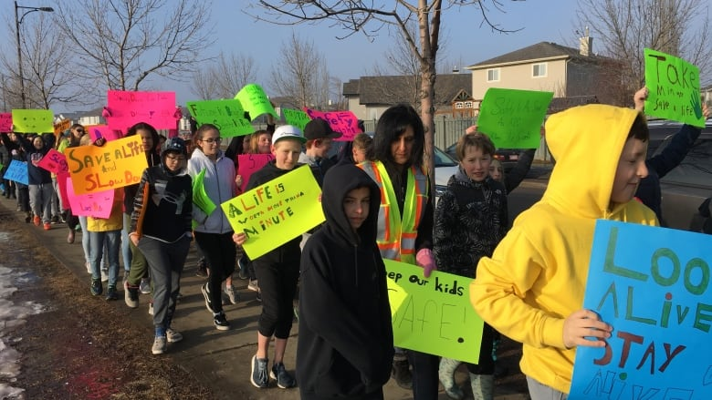 Edmonton students rally for pedestrian safety after classmates struck by bus