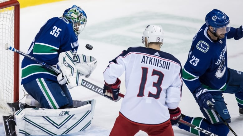 8e337b87fd325 The Columbus Blue Jackets picked up a crucial two points with a 5-0 win  over the Vancouver Canucks on Sunday. (Darryl Dyck Canadian Press)