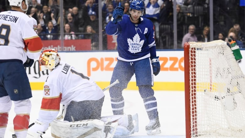 a94edb500b3 Toronto s John Tavares celebrates his third of four goals against the Florida  Panthers in the Leafs  7-5 win on Monday. (Nathan Denette Canadian Press)