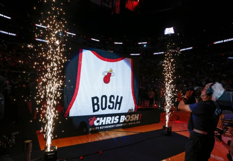 534dd3798c2 Chris Bosh s jersey is raised to the rafters in Miami after a ceremony  Tuesday retiring his No. 1. (Joe Skipper Associated Press)