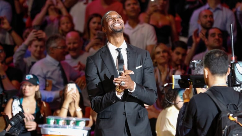91ea229bc2c Former Miami Heat player - and Toronto Raptor - Chris Bosh is introduced at  a ceremony in Miami retiring his No. 1 jersey. (Joe Skipper Associated  Press)