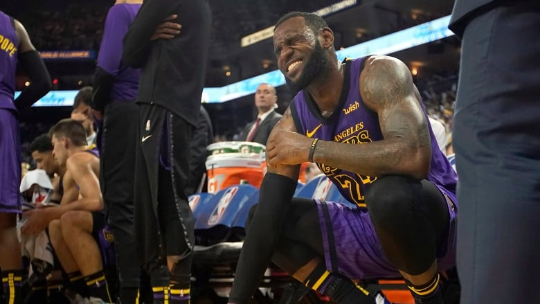 8c761e52bc0 25, 2018, file photo, Los Angeles Lakers forward LeBron James (23) reacts  after straining his left groin during the second half of an NBA basketball  game ...