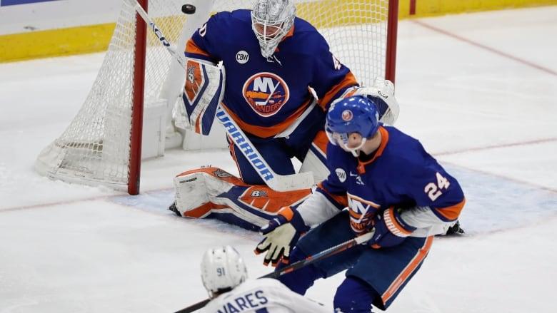 b1d97772 Toronto's John Tavares beats Islanders goalie Robin Lehner for his first  goal against his former team. It was Tavares' 46th goal of the season and  the ...