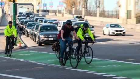 STOCK CYCLISTS BICYCLE VANCOUVER BURRARD BRIDGE BIKE CYCLE