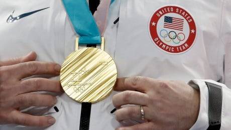 Canadian fans find it hard to love an American with a curling gold medal