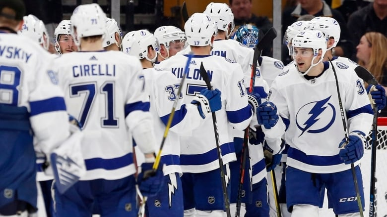 591c7c57d12d56 Tampa Bay Lightning's Cameron Gaunce celebrates with teammates after  defeating the Boston Bruins 6-3 on Saturday, April 6, 2019.