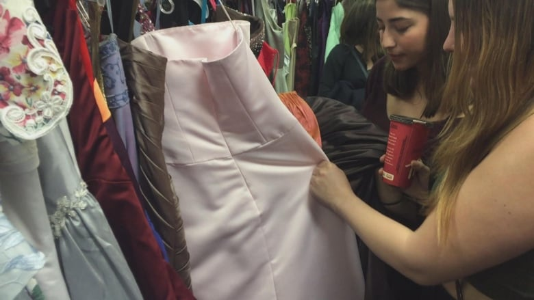 5745bd73a8c GownTown at Marlborough Mall allows graduating students in Calgary to buy  gently-used graduation dresses for  10. (Lucie Edwardson CBC)
