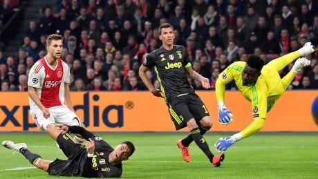 Ronaldo returns with a goal as Juventus draws Ajax in 1st leg