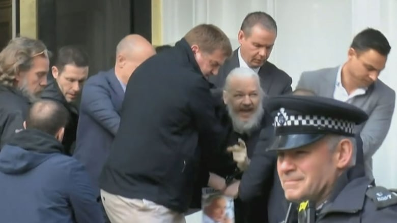 Julian Assange arrested after U S  extradition request, charged with