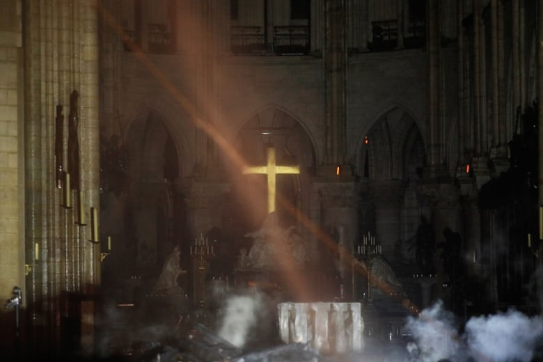 Macron promises to rebuild Notre-Dame Cathedral after fire, seeks international help